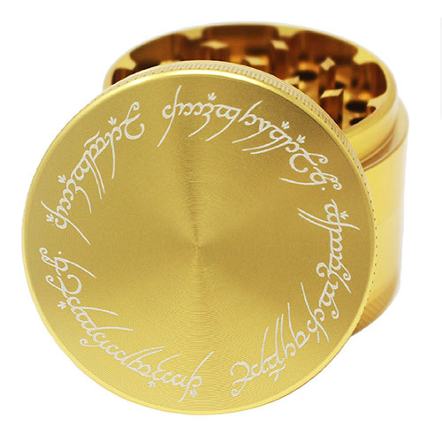 A shiny gold Lord of the Rings grinder for cannabis buds